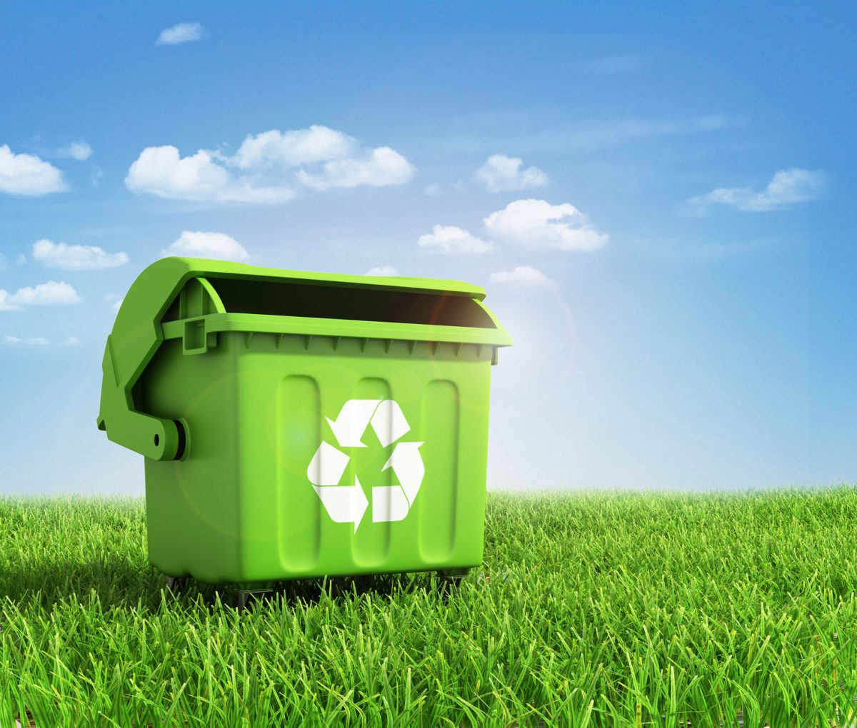 green plastic trash recycling container with landscape background