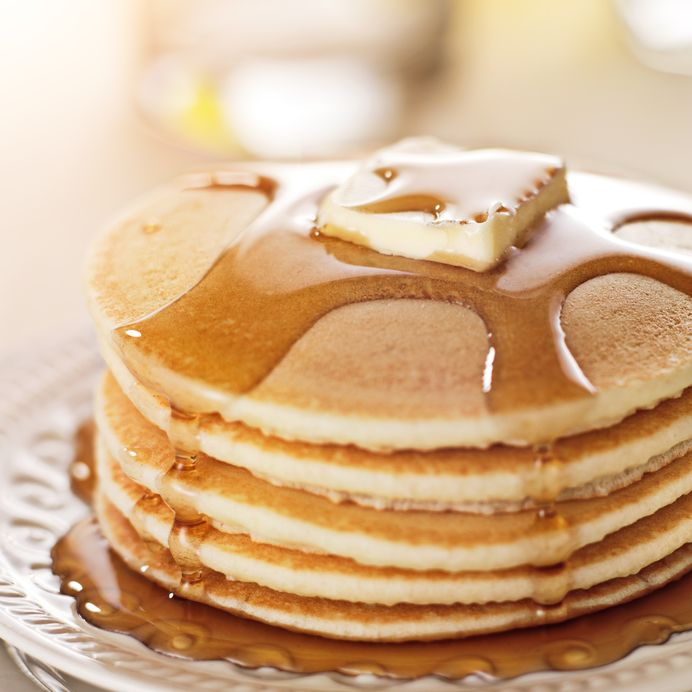 Stack of pancakes with syrup and butter