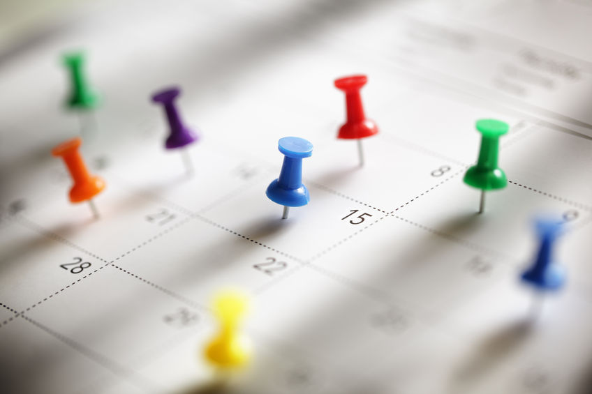 Calendar with thumb tacks on important dates