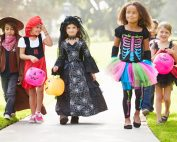 Children in costume dress going trick or treating