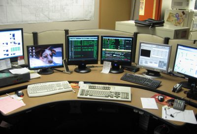 police dispatch office with multiple computers