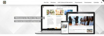 New website layout on a laptop, tablet and smart phone